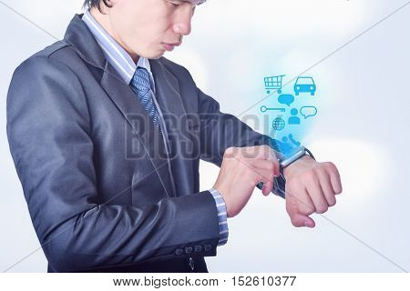 Business Man uses smart watch with technology icon concept on white background