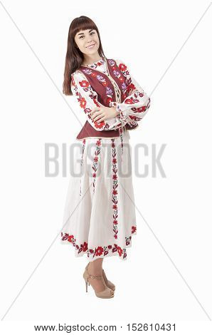 Full Length Portrait of Happy Smiling Brunette Woman Posing in Unique Hand-Made Flowery National Costume Dress. Against Pure White Background. Vertical Orientation
