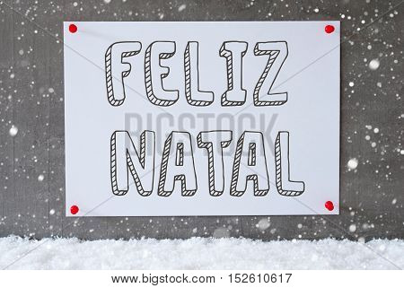 Label With Portuguese Text Feliz Natal Means Merry Christmas. Urban And Modern Cement Wall As Background On Snow With Snowflakes.