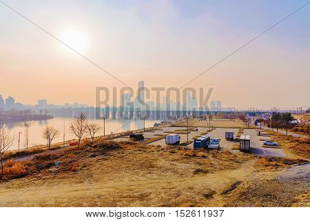 View of Han river in Seoul with buildings in the distance
