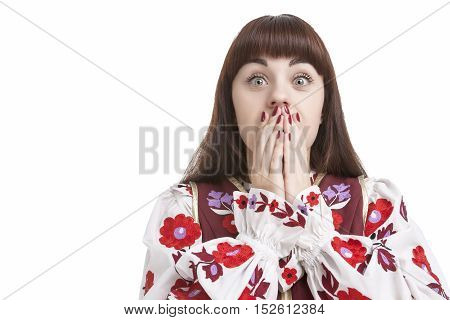 Natural Portrait of Frightened Caucasian Female. Posing with Hands Closing Mouth. Against Pure White. Horizontal Image Orientation