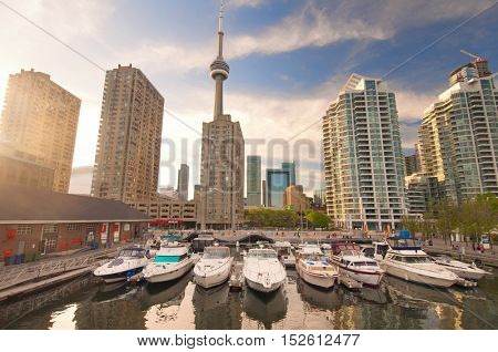 View of the harbour front marina with toronto skyline in the background at sunset
