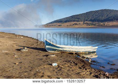 Old boat at the coastline of Batak Reservoir, Pazardzhik Region, Bulgaria