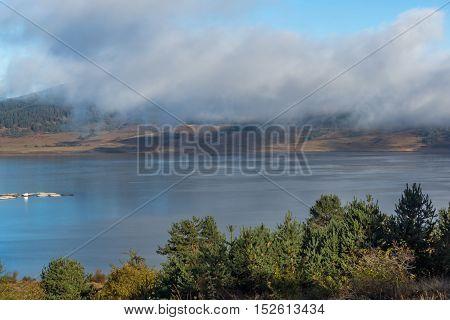 Amazing view of Low clouds over water of Batak Reservoir, Pazardzhik Region, Bulgaria