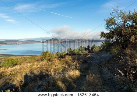 Autumn Landscape with Low clouds over water of Batak Reservoir, Pazardzhik Region, Bulgaria