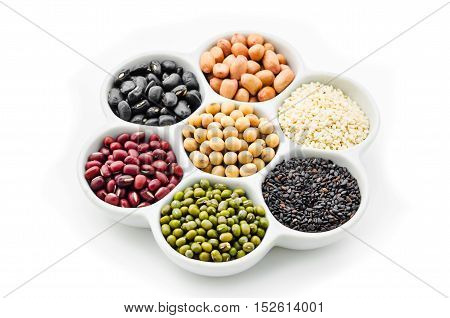 A variety of nuts in a cup isolated on white background.