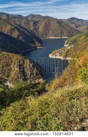 Panoramic view of Tsankov kamak Reservoir and Autumn forest, Smolyan Region, Bulgaria
