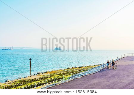 Portsmouth with cyclists walking down in the summer