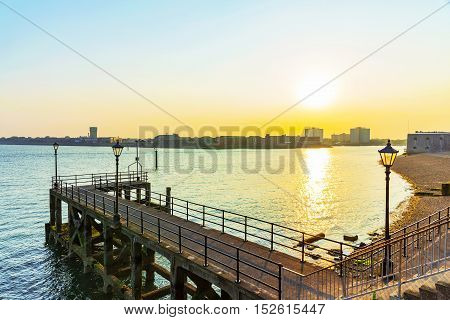 Small pier in Portsmouth with sunset and sea