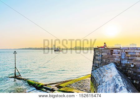 View of castle with Portsmouth Seafront at sunset