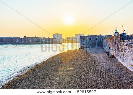 View of Portsmouth seafront area and sunset