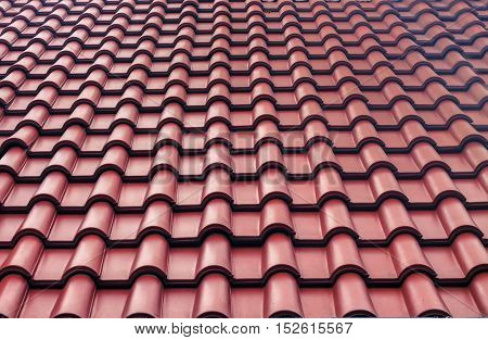 Red tiles roof textured background. Closeup exterior. Repeat surface