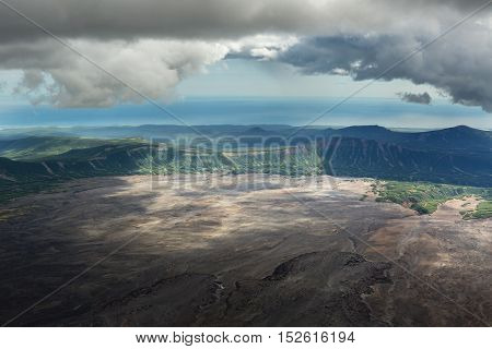 Caldera volcano Maly Semyachik. Kronotsky Nature Reserve on Kamchatka Peninsula. View from helicopter.