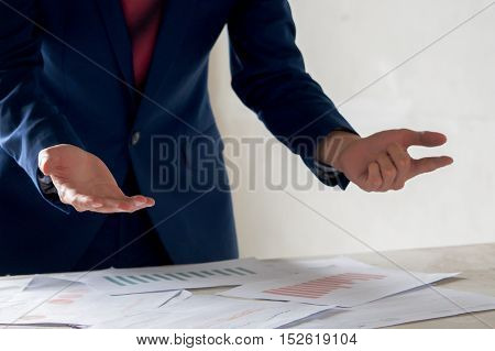 Business Man Presenting Financial And Accounting Report In The Business Meeting With Open Hands Gest