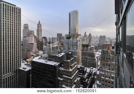 Aerial View of the skyscrapers of downtown Manhattan in New York City after a snowstorm.