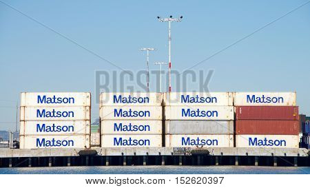 Oakland CA - September 27 2016: Shipping containers stacked on the dock at the Matson terminal Port of Oakland. Matson provides shipping services Pacific wide. Mainly to and from the Hawaiian Islands.