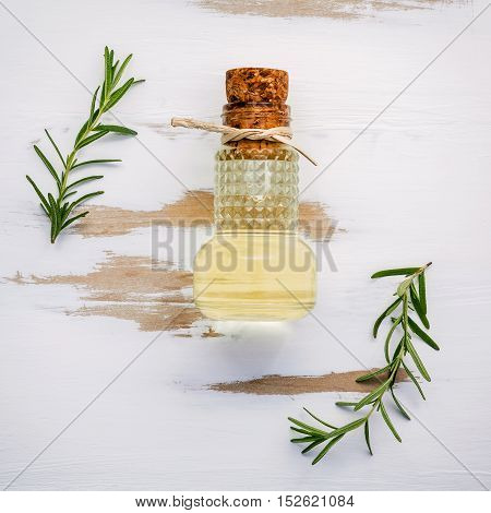 Bottle Of Extra Virgin Olive Oil With Rosemary. Sprigs Of Rosemary And Olive Oil Set Up On White Sha