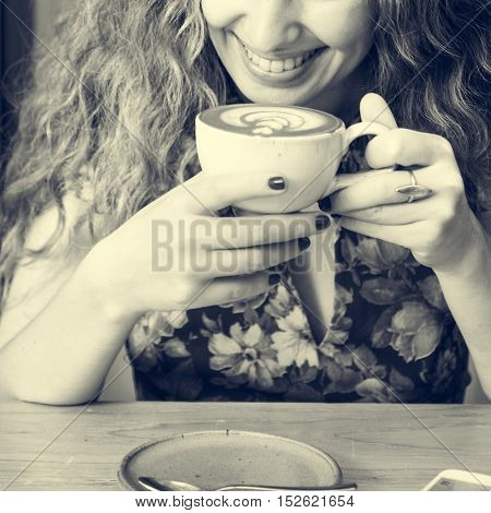 Young Woman Drinking Coffee Concept