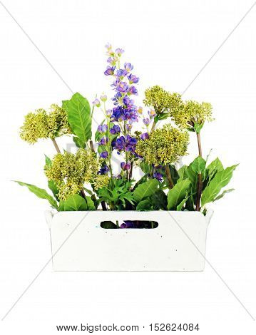 Composition of artificial garden flowers in decorative vase isolated on white background.