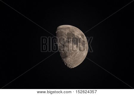 A close up three-quarter telephoto view of the moon