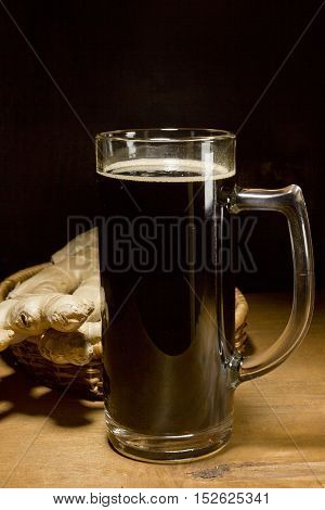 Lithuanian brew ginger and ginger root on a wooden table