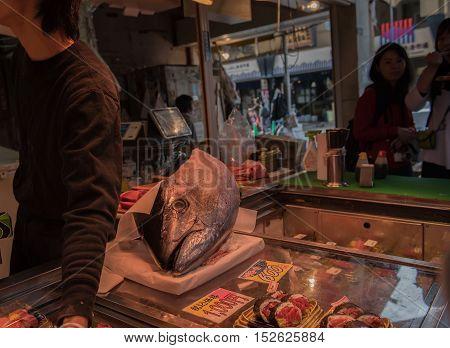 TOKYO  , JAPAN - OCTOBER 12 ,2016 : The big fresh fish For Sushi by Chefs at Tsukiji market. Famous food of Japan.