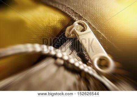 Bag and zipper black light yellow light effect.