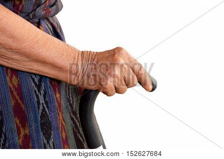 isolated hand of old woman holding walking cane