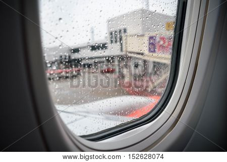 Inside a plane park in airport Raindrop on the window Selective focus. Sad