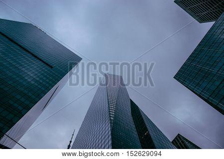 new york city sky scraper buildings looking up