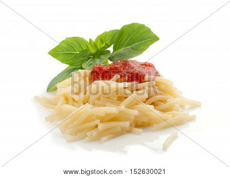 Isolated handful of boiled vermicelli with tomato sauce and fresh green basil
