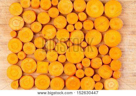 Chopped Carrots Arranged On Cutting Board