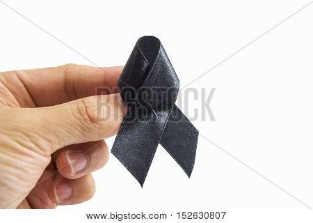 Mourn ribbon in the hand on white background