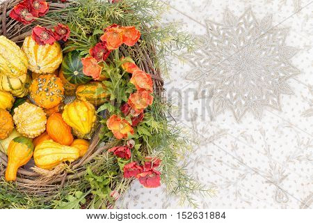 Colorful Fall Centerpiece With Gourds And Flowers