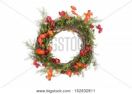 Autumn wreath with fresh green foliage and colorful orange flowers arranged on an intertwined twig base isolated over white