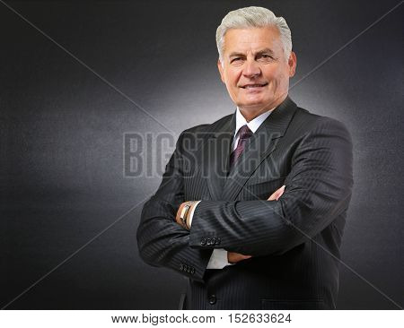 Portrait of teacher on chalkboard background