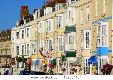 WEYMOUTH, UNITED KINGDOM - JULY 19, 2016 - Row of guesthouses along the Esplanade promenade Weymouth Dorset England UK Western Europe, July 19, 2016.