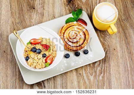 Photo of healthy breakfast on wooden background