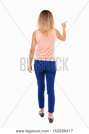 back view of pointing walking  woman. going girl pointing.  backside view of person.  Rear view people collection. Isolated over white background. blonde in a pink t-shirt goes the distance pointing.
