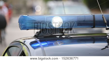 Spot Light And Blue Flashing Lights Of The Police Car