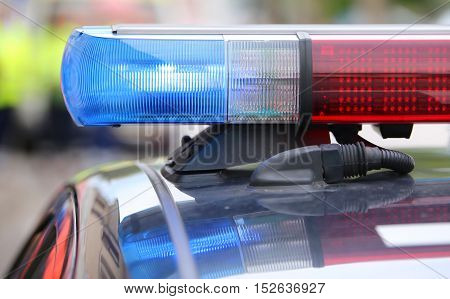 Big Red And Blue Flashing Lights On The Police Car During The Re