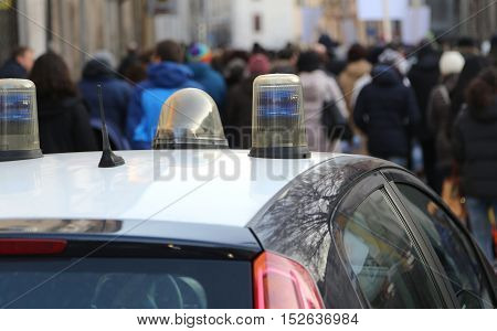 Police Car Escorted The Protesters During A Street Protest