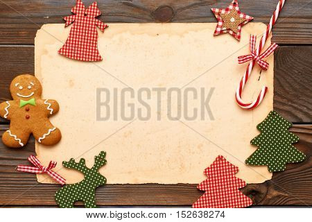 Christmas homemade gingerbread cookie and handmade decoration on wooden background