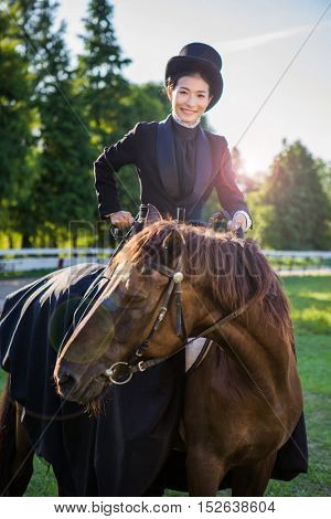 Asian girl riding her horse at her stables