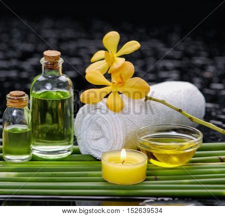 spa concept â??yellow orchid and towel, green long leaf,soap,oil
