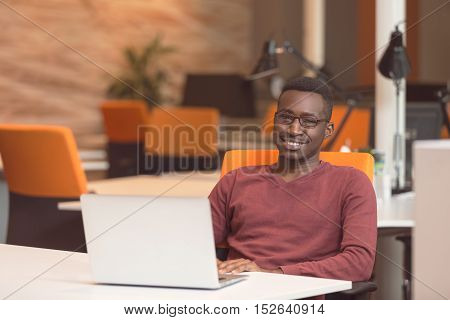 Handsome Smiling Successful African American Man Wearing Formal Suit, Oval Glasses, Using Laptop Com