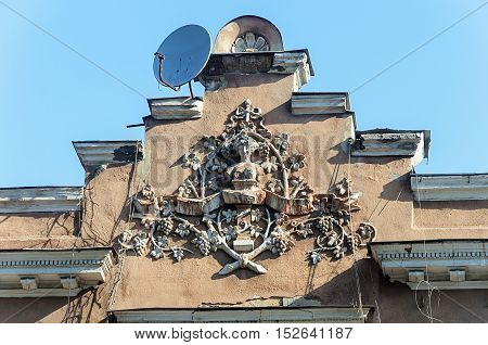 Coat of arms on the pediment of old building in Odessa Ukraine