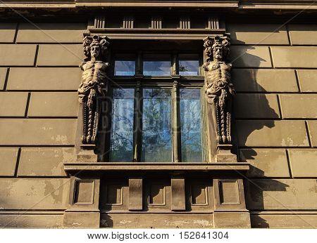 Window of old building with caryatids in Odessa Ukraine