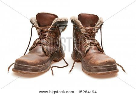 old brown boots isolated on white