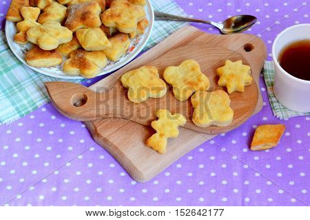 Salt cheese biscuits - homemade cheese biscuit on a wooden board, cup of tea